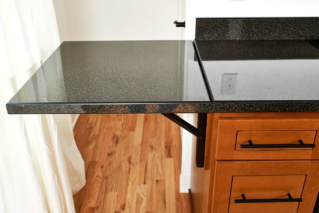 Kitchen design includes a custom countertop that folds up when you need extra countertop space.