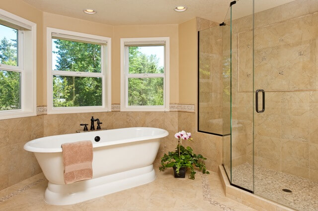 The master bath design specified a freestanding tub to visually enlarge the room.