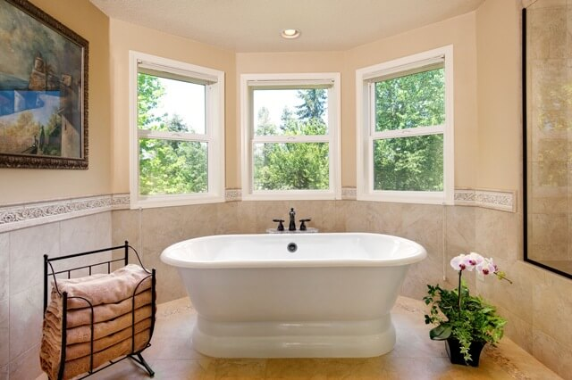 Our designers specified a freestanding roman tub to visually enlarge the room.