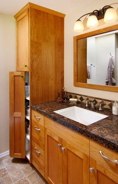 The remodeled guest bath features a granite tile counter and travertine floors.