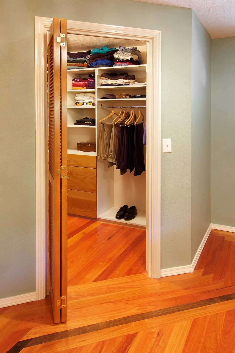 The remodeled master suite includes a well-organized walk-in closet.