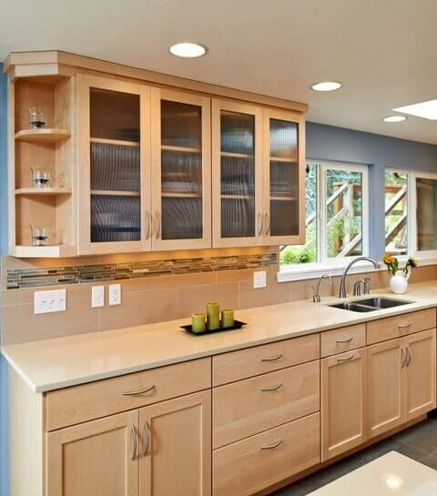 This sleek kitchen design features maple cabinets and Caeserstone counters.