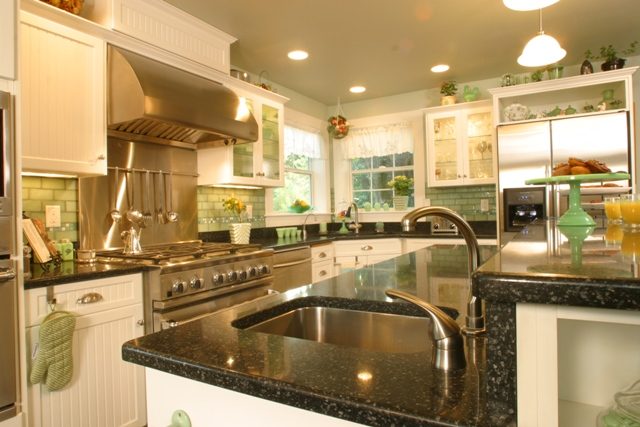 A new island with Uba Tuba granite counters and its own prep sink increases the versatility of the remodeled kitchen.
