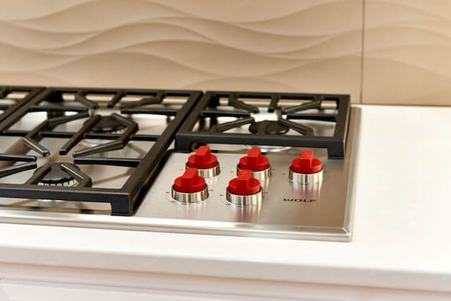 The Wolf cooktop is both dramatic and functional.