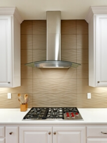 This Zephyr Ravenna hood and Wolf cooktop are the crowned jewels of this stunning kitchen remodel.