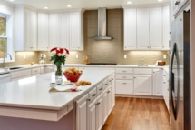 This white kitchen has contemporary design elements that set it apart.