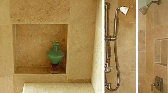 Recessed niches in the shower and a hand held shower sprayer.