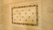 A tile mural in the shower of the master bath.