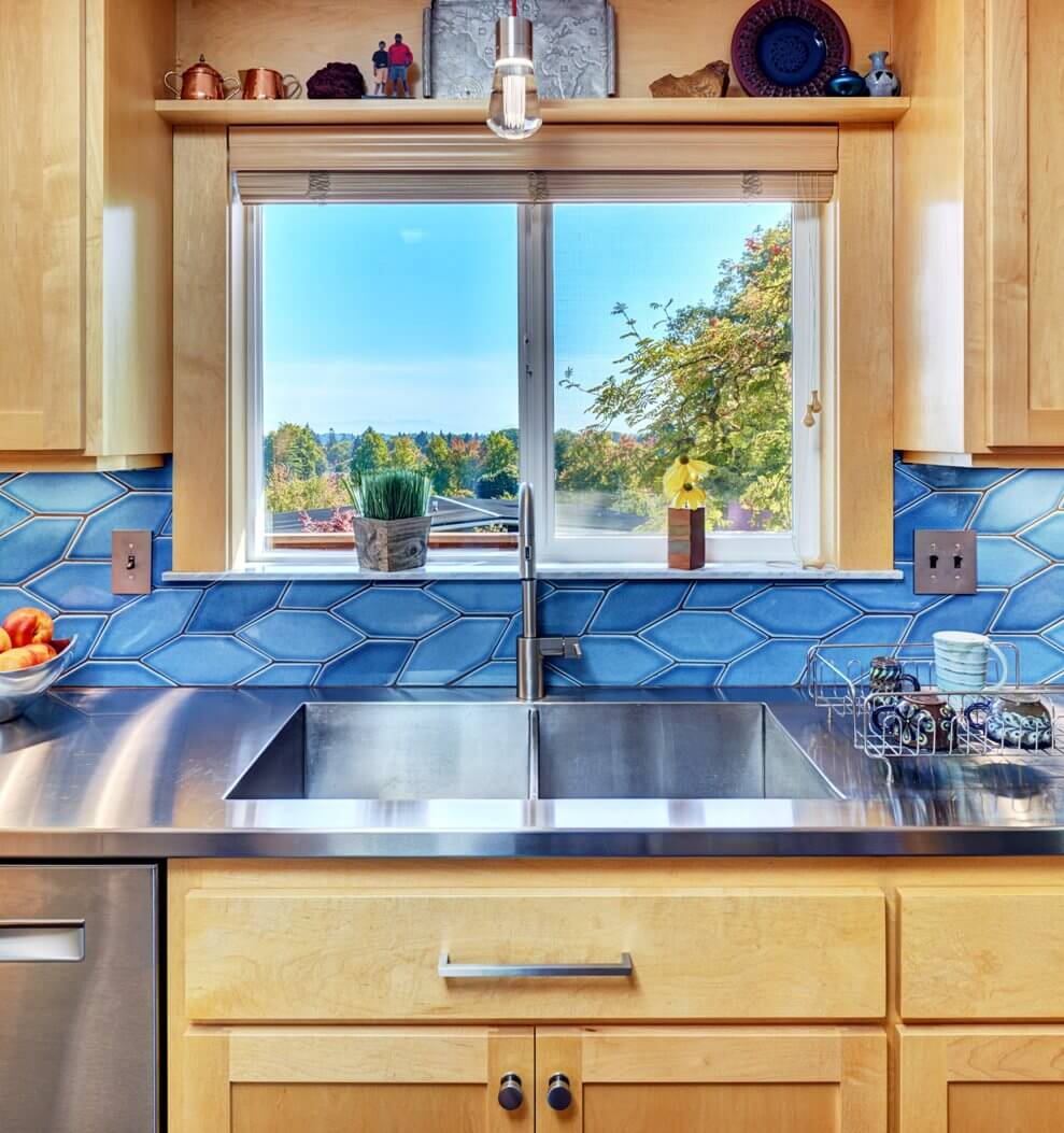 Stainless steel countertops and integrated stainless sink make this kitchen design a real stand out