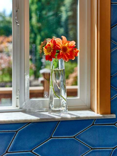 A marble window sill is a special feature of this kitchen