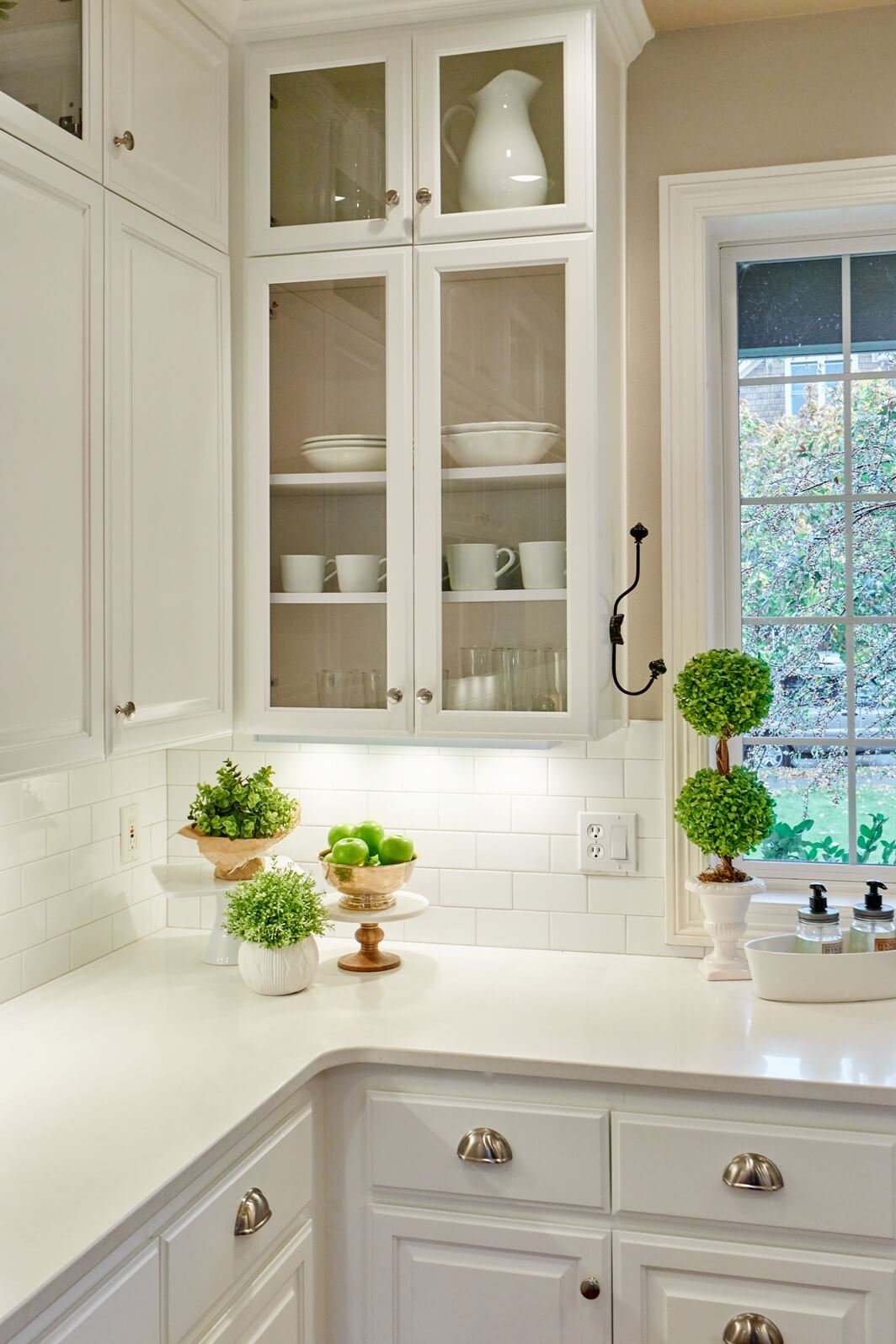 We completed the kitchen renovation by painting the existing cabinets white and adding second-tier upper cabinets.