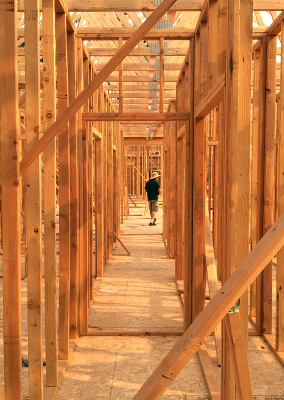 General contractor Tom Powell walks through the framing of a new home.