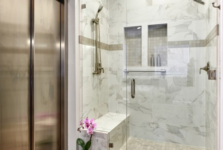 elevator opens up in bathroom next to large walk in shower
