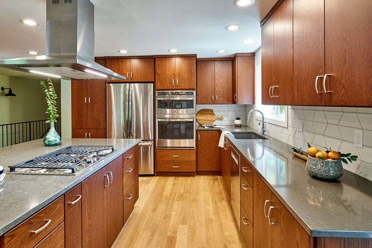 overview of kitchen featuring oak cabinets and hardwood floors
