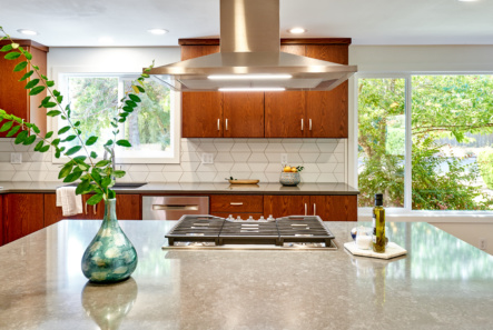 gray quartz countertop on island with natural wood cabinetry