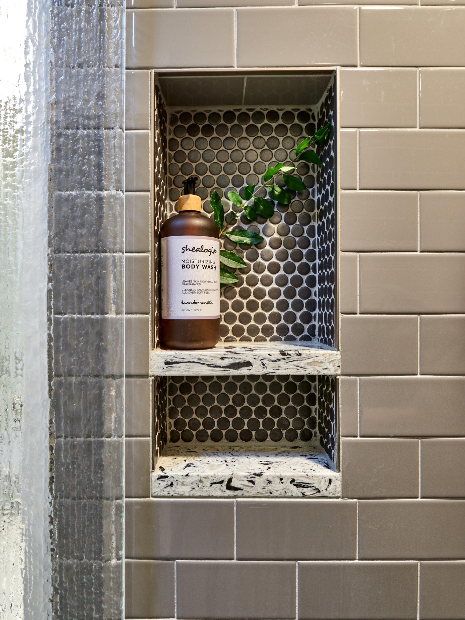 recessed shower niche with quartz shelves