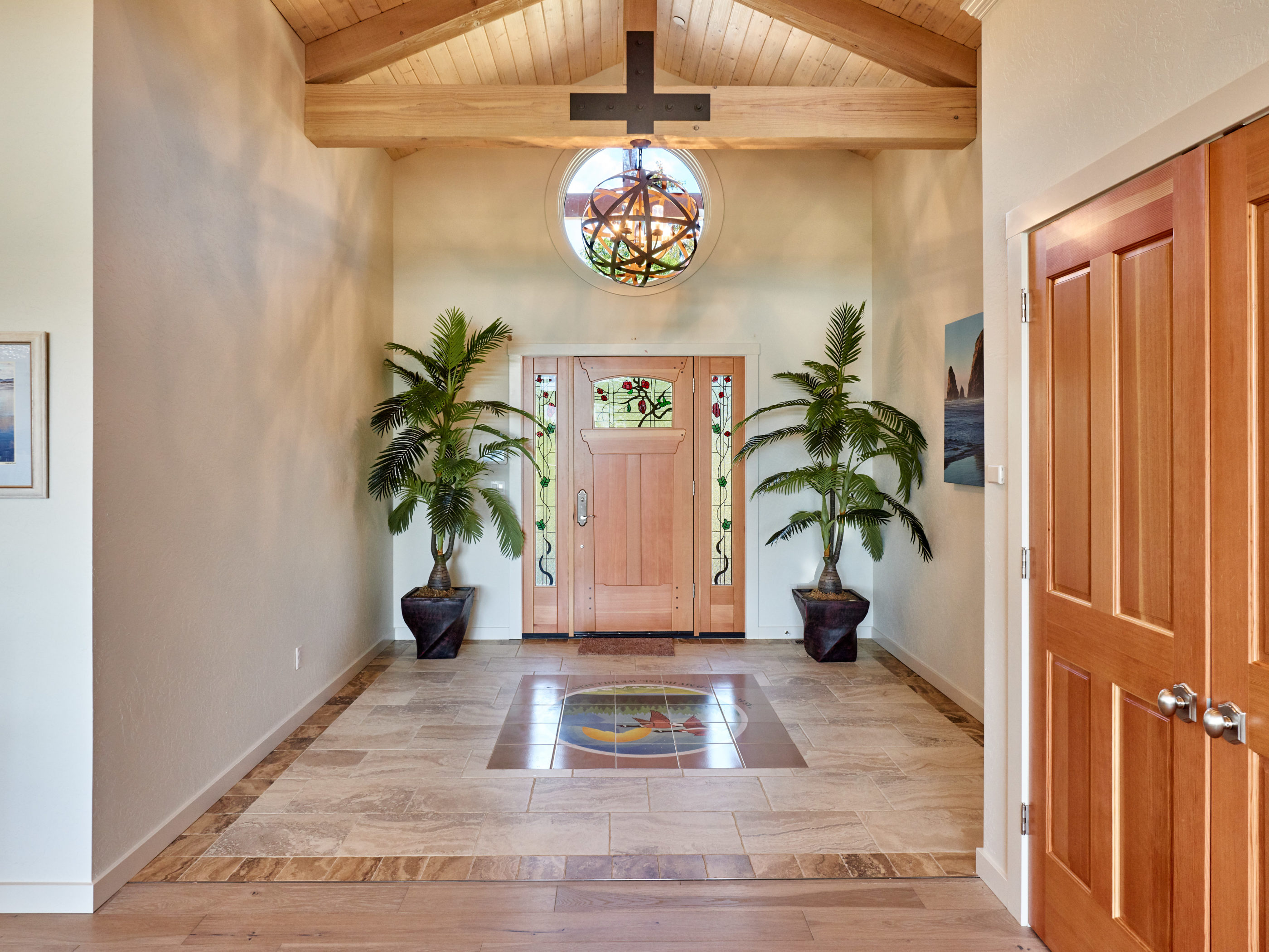 entry way with timber beams and tile flooring
