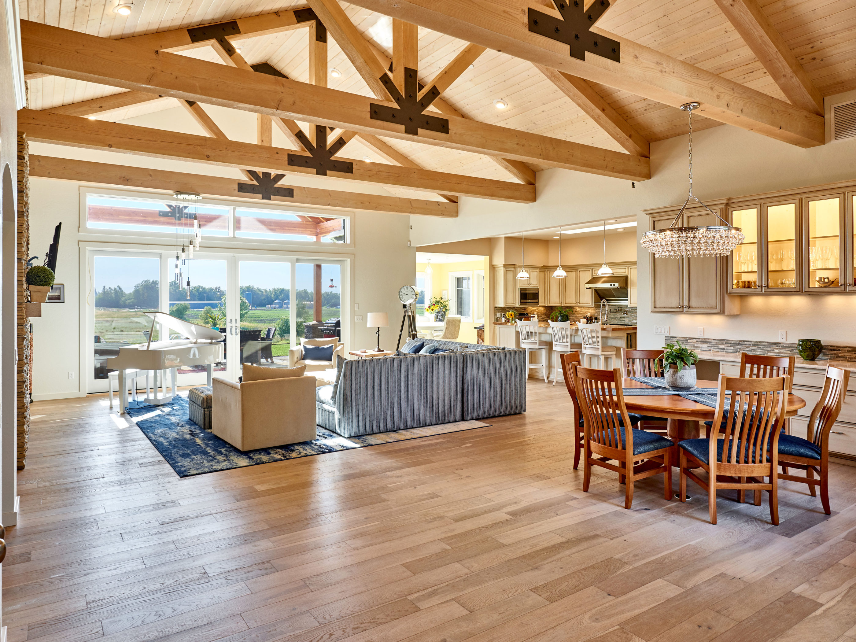 open concept living area with timber beams