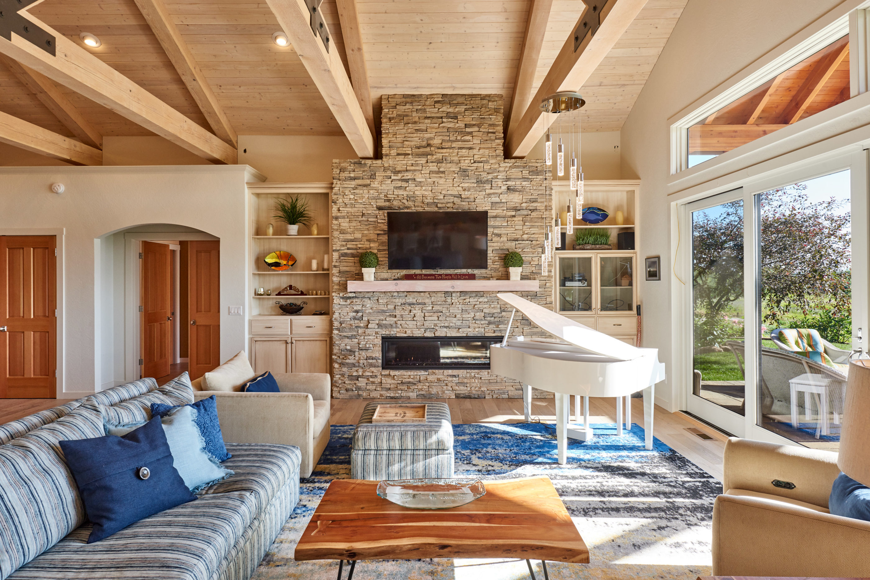stone fireplace with horizontal timber beams on ceiling