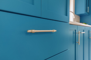 Closeup of blue drawer with satin nickel pull
