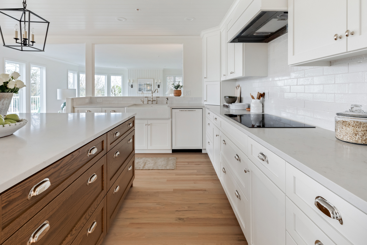 White and natural wood cabinetry in kitchen
