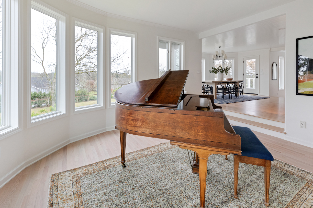 Beautiful grand piano with large windows