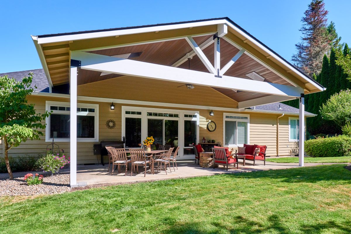 The addition of a new patio cover lends height and dimension to the rear of the house.