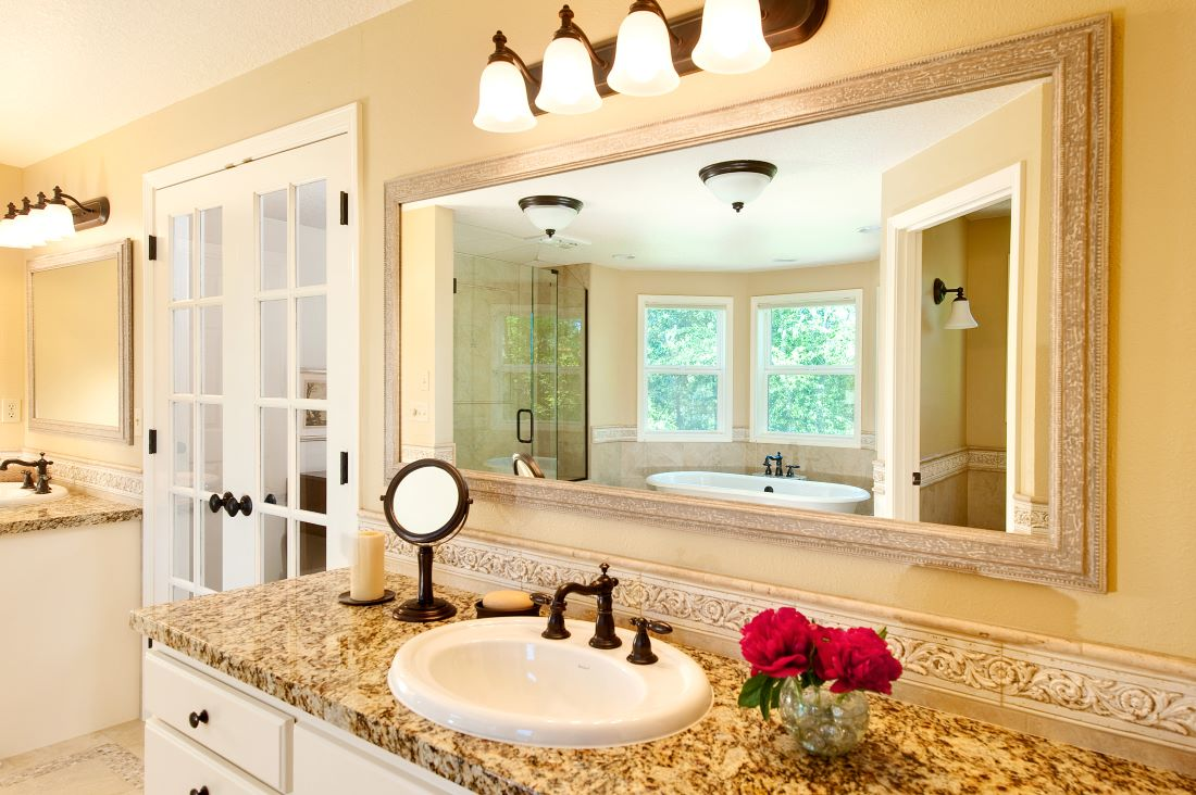 The remodeled bathroom features two vanities for plenty of elbow room.