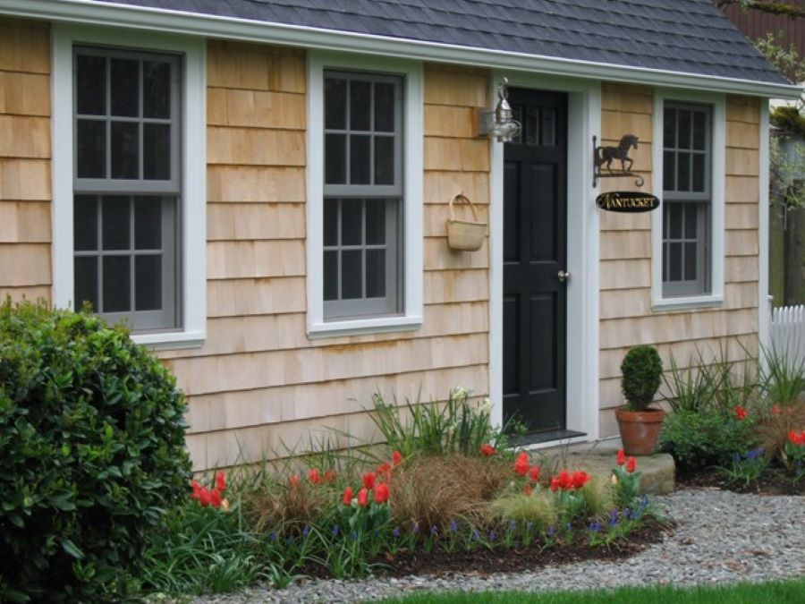 Alaskan yellow cedar siding was used used to authentically replicate the Cape Cod style.