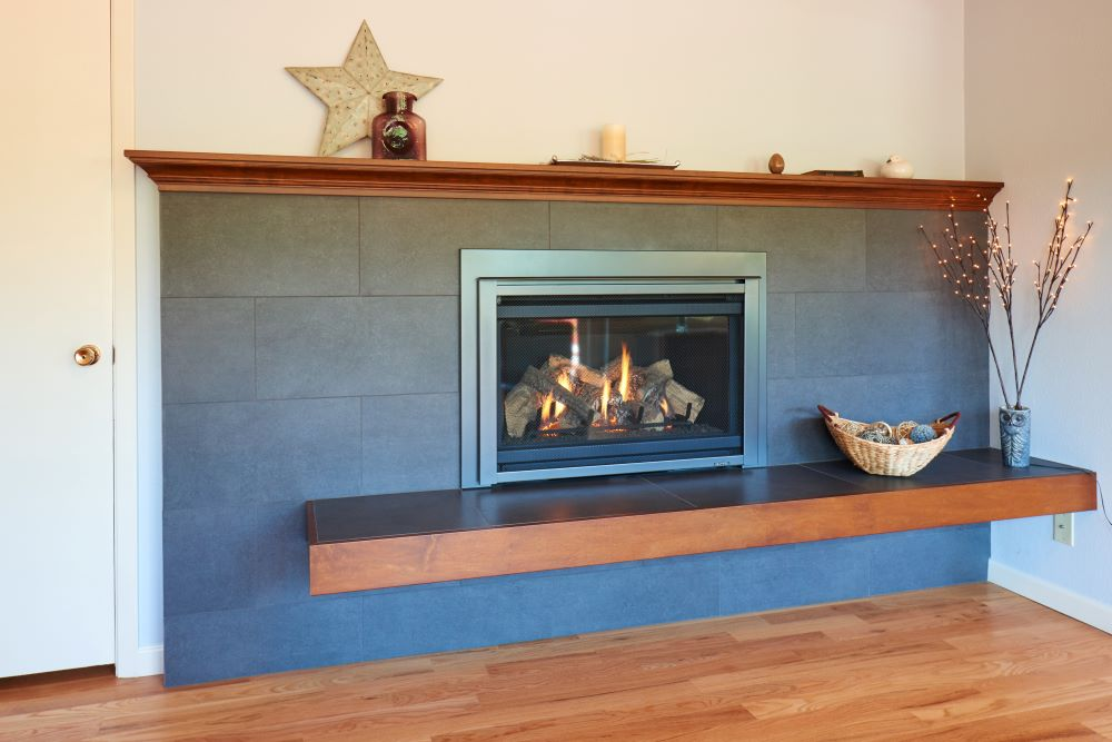 The renovated fireplace reflects finishes in the adjacent kitchen, unifying the spaces.