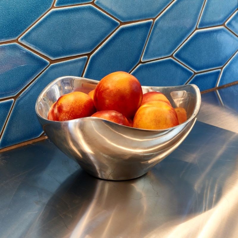 Blue tile and stainless steel counters are a stunning combination