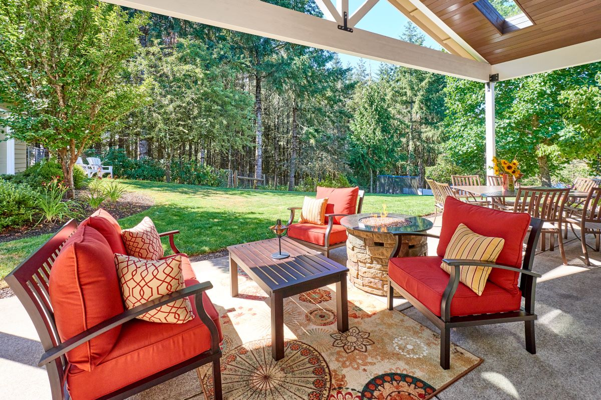 The new outdoor living space includes a propane-fueled fire pit.