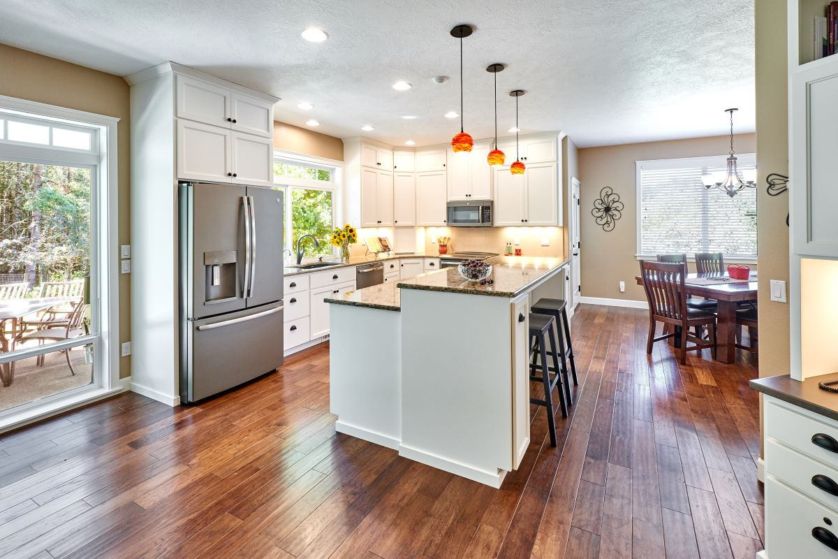 The renovated kitchen is part of an open and bright great room.