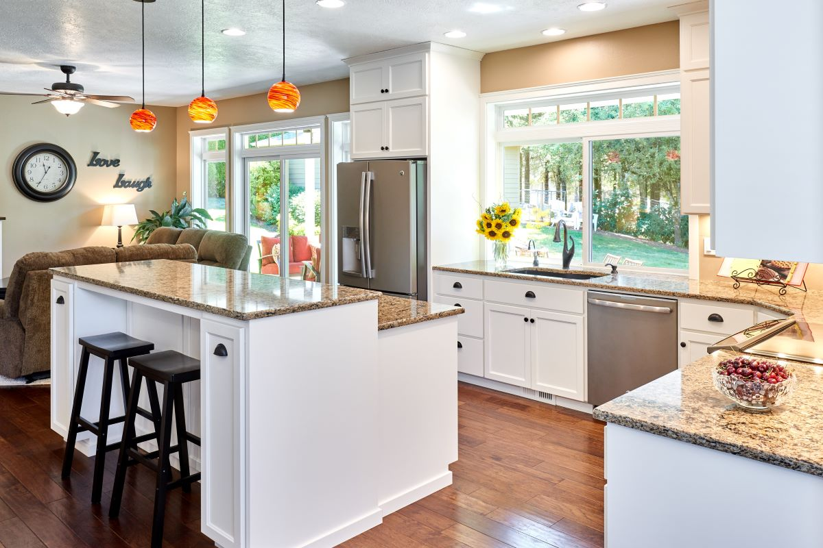 The newly renovated kitchen is intimately tied to the outdoor living space.