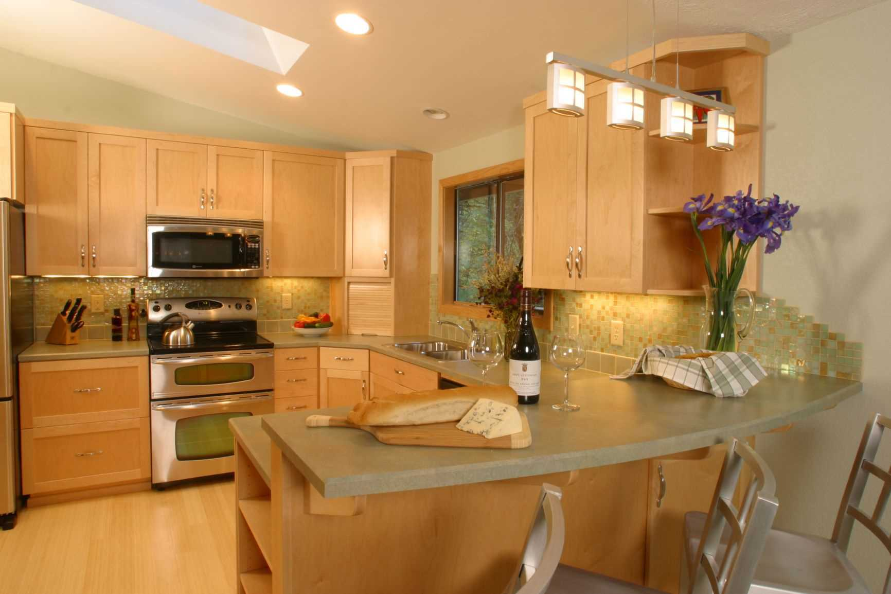 This carefully designed small kitchen remodeled to make the room appear larger and more inviting.