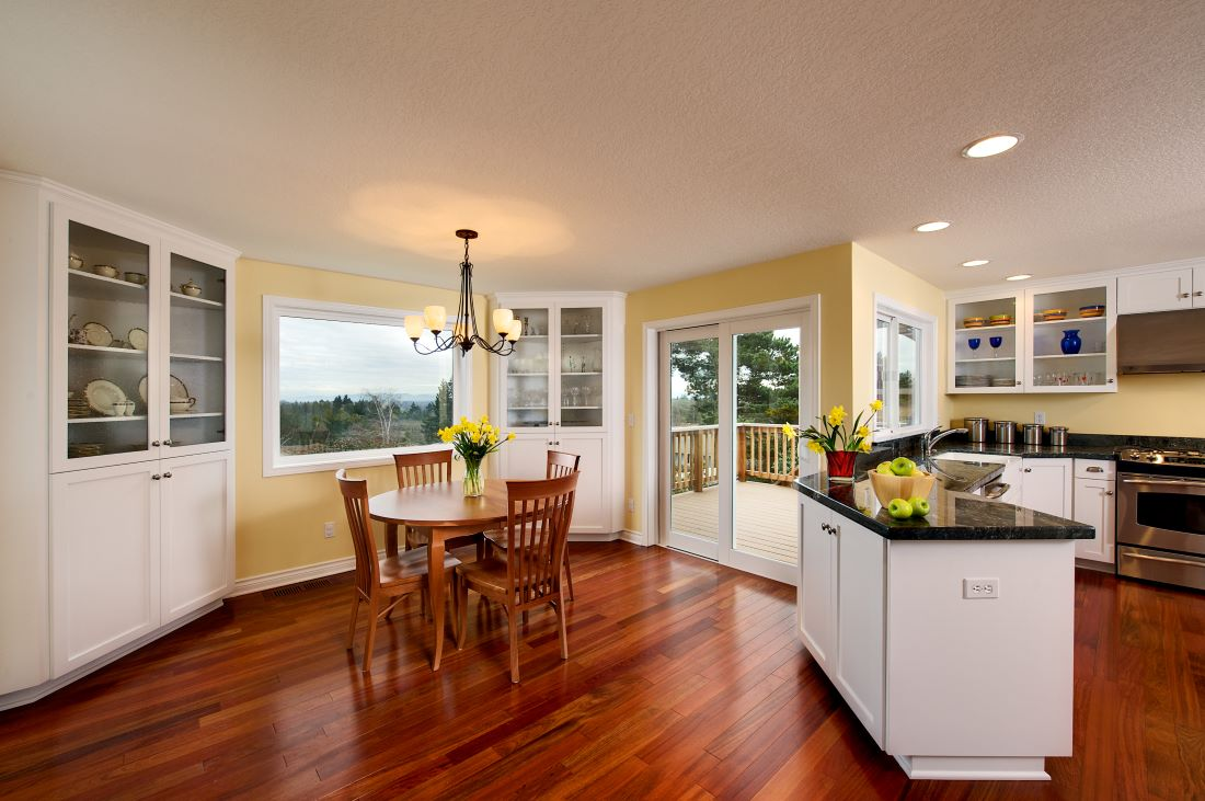 A dining room addition and newly remodeled yellow kitchen.