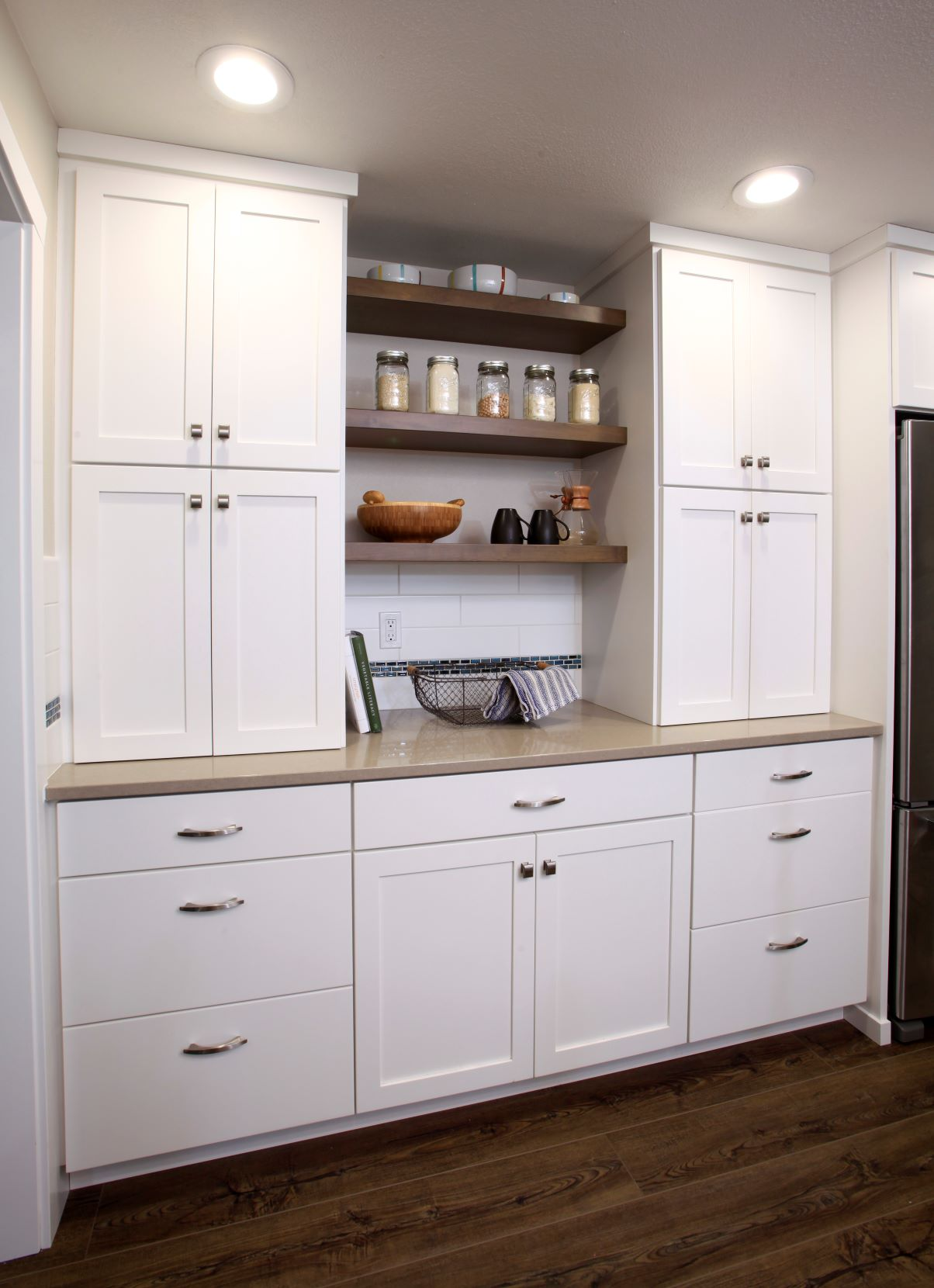 The redesigned kitchen includes plenty of storage space.