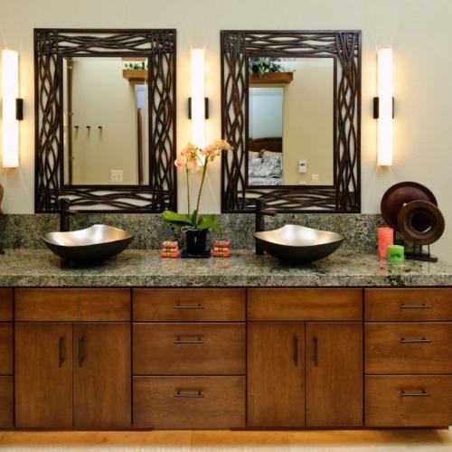 This bathroom remodel features Julia Wawirka vessel sinks and Tec Lighting sconces.