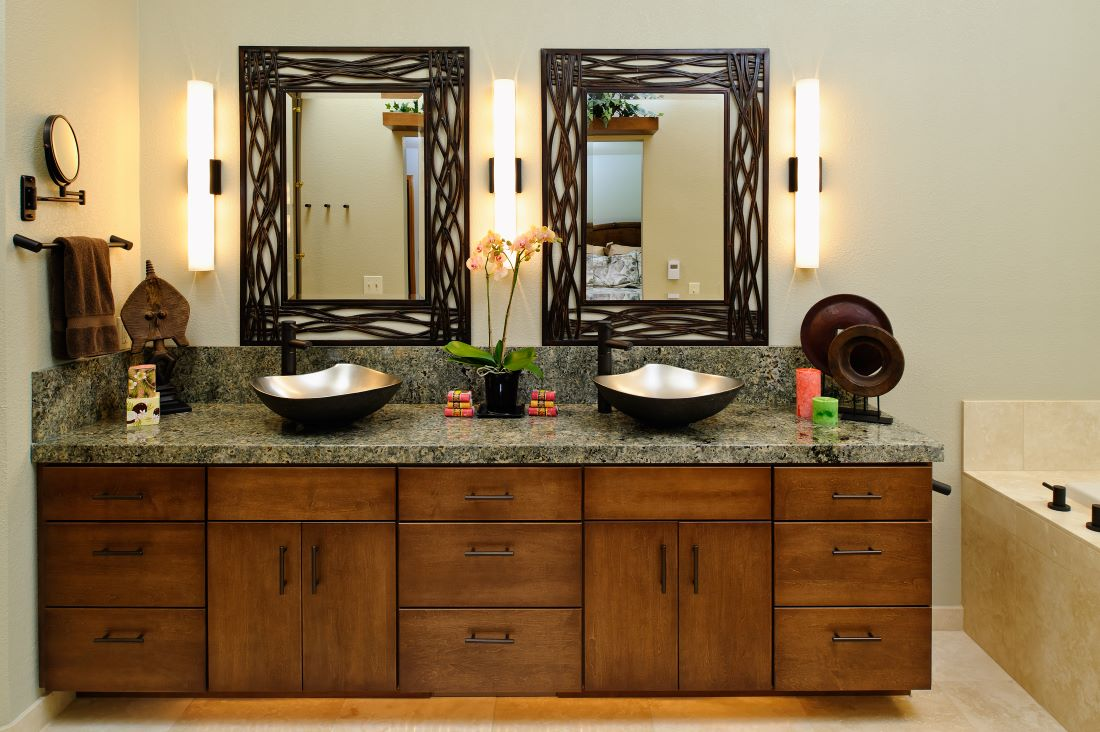 This bathroom remodel features Julia Wawirka vessel sinks and Tec Lighting sconces.