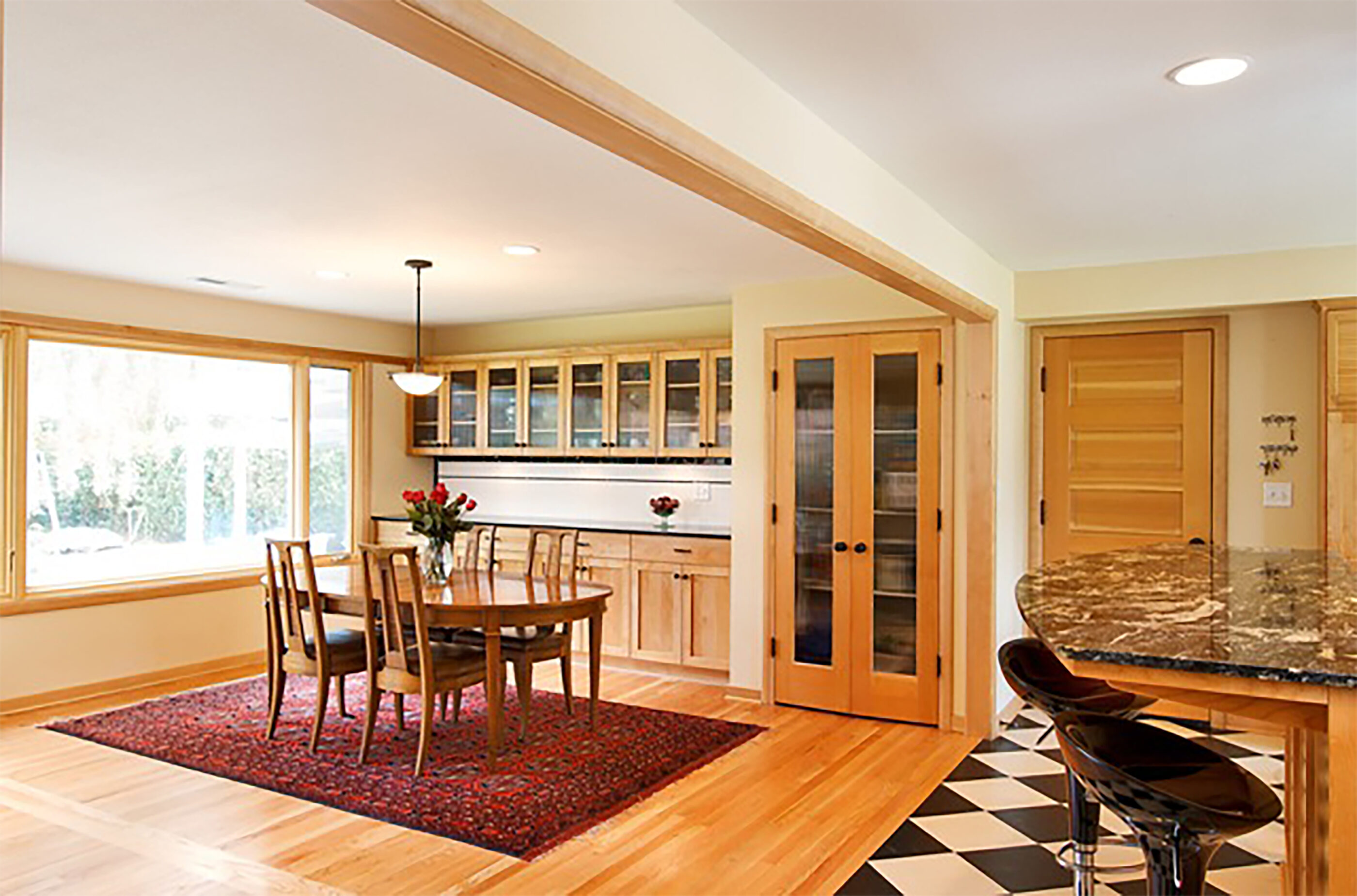 The dining area features custom built-in cabinetry for additional storage which also serves as a buffet area.