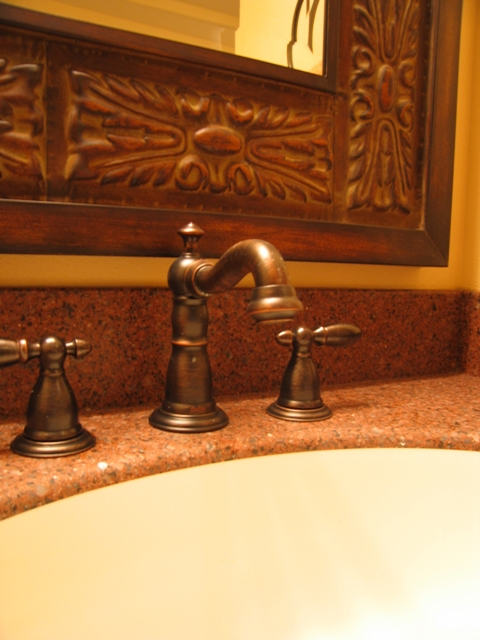 A Delta faucet with Venetian Bronze finish pairs well with a Steller LG HiMacs integrated sink.