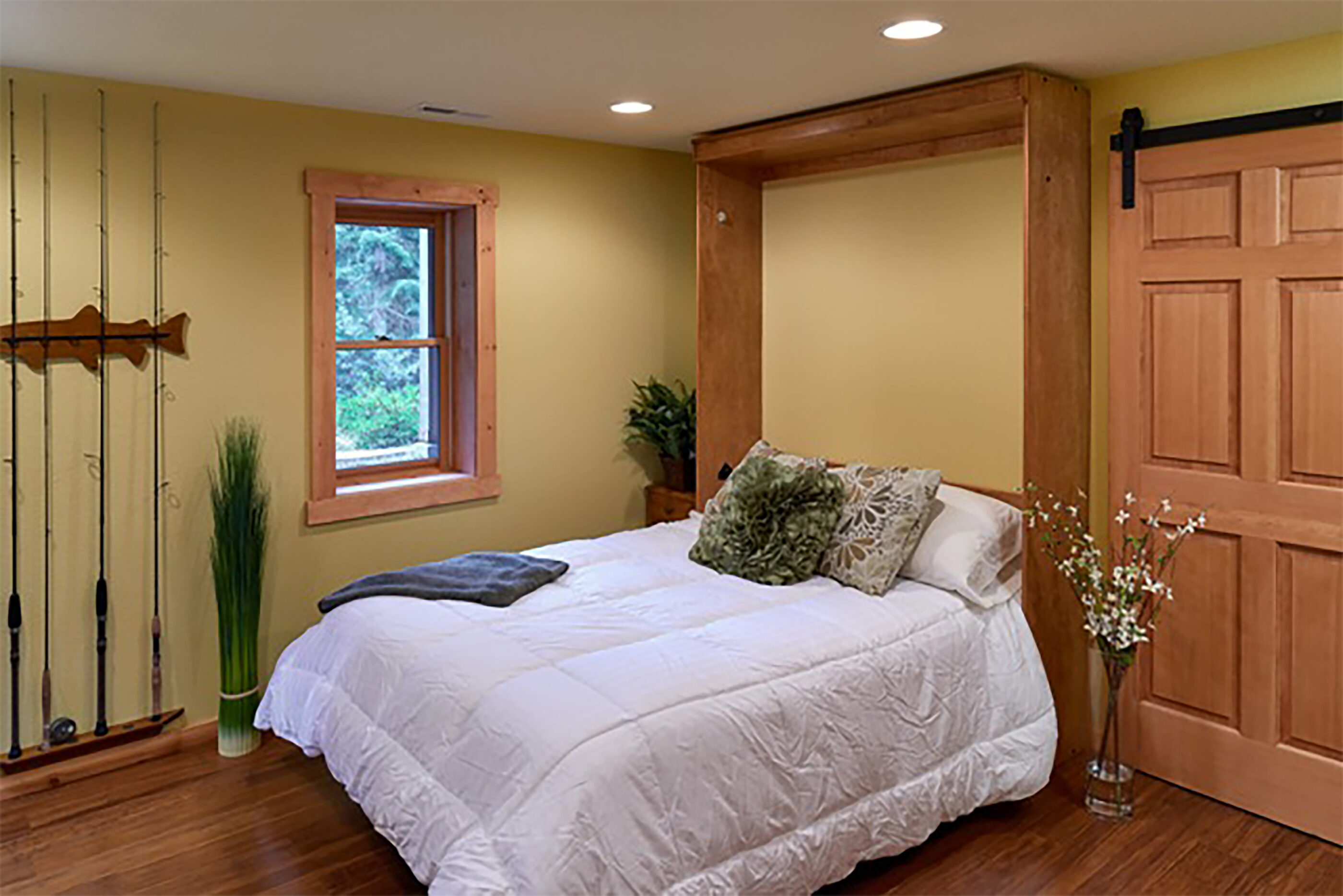A murphy bed folds down when guests come to visit.