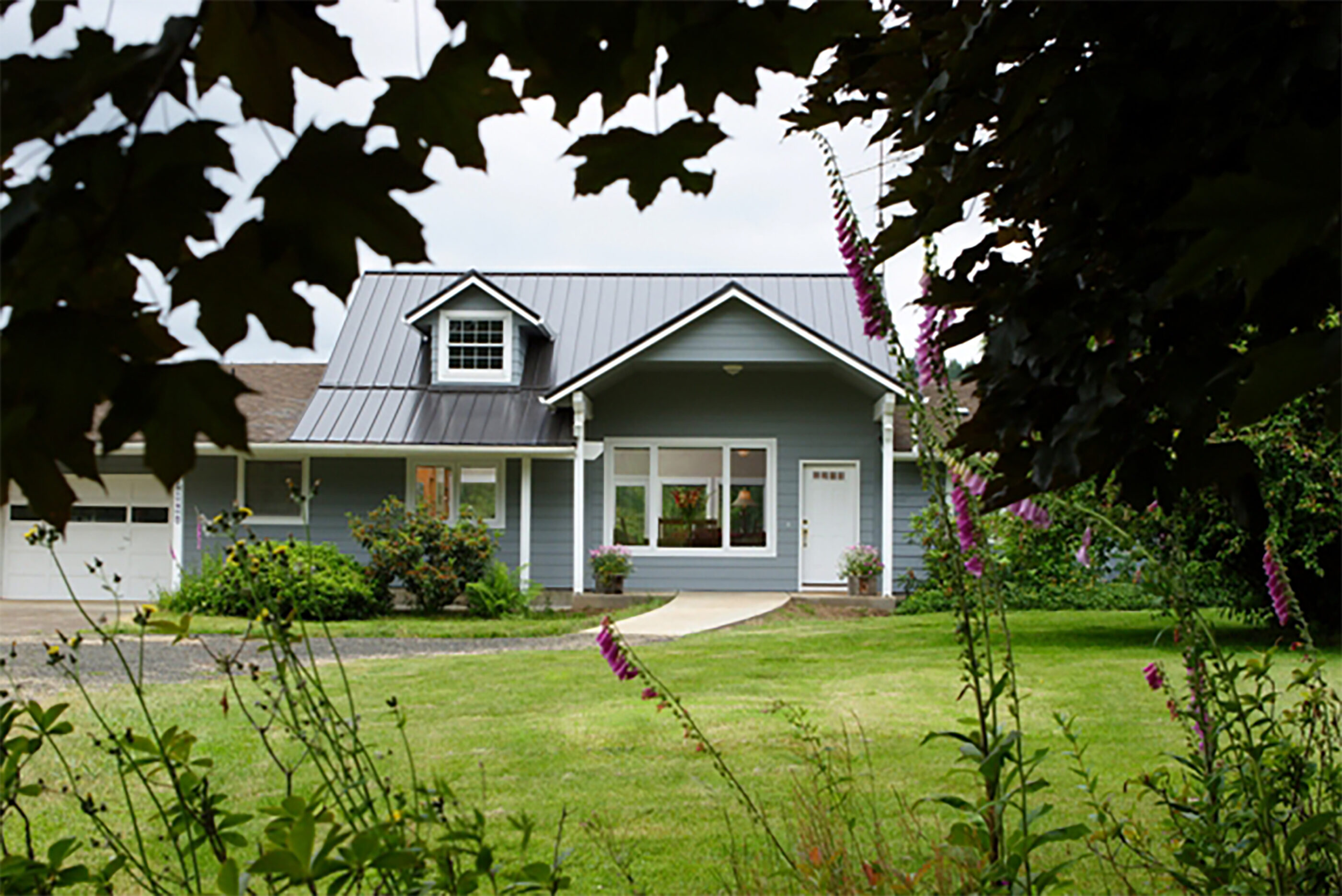 The change to the roofline and the addition of a gable over the front door gives the home's exterior more presence .