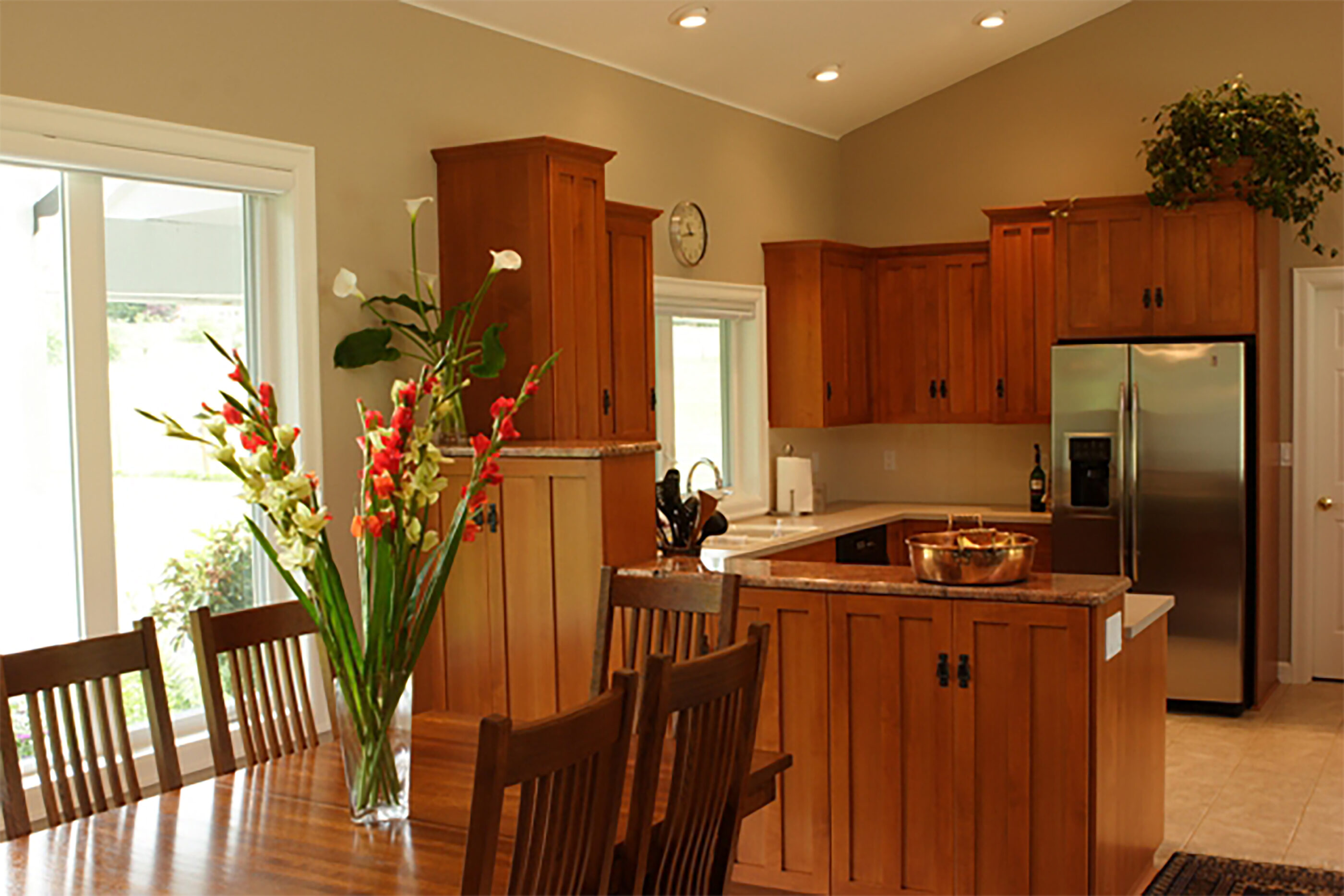 The newly remodeled kitchen with higher ceilings after the roof was raised.