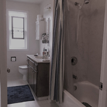 Dated tub/shower combo with vinyl floors