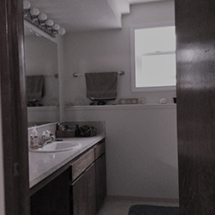 Dated vanity with old light fixtures