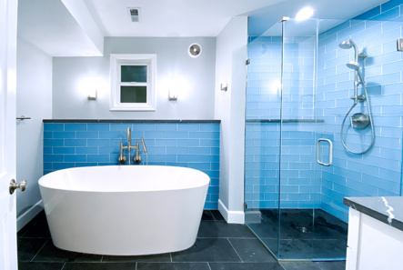 Oval freestanding tub with black slate floors